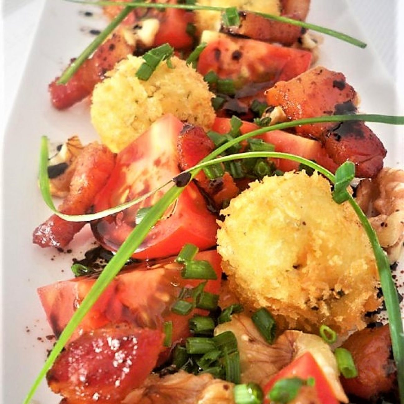 Tomato Salad with goat cheese, pancetta and walnuts